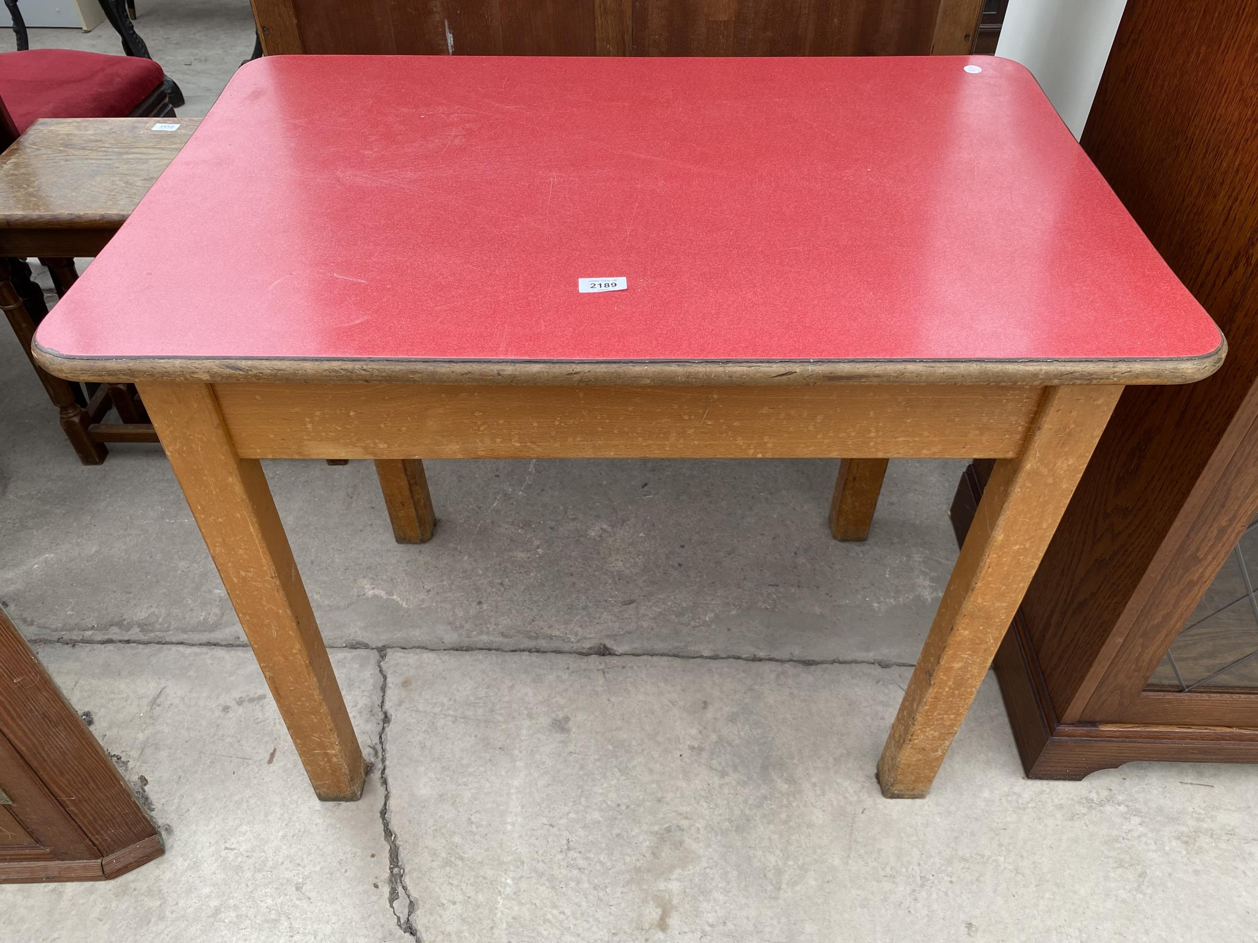 """A 1950'S FORMICA TOP TABLE 35""""X22.5"""""""