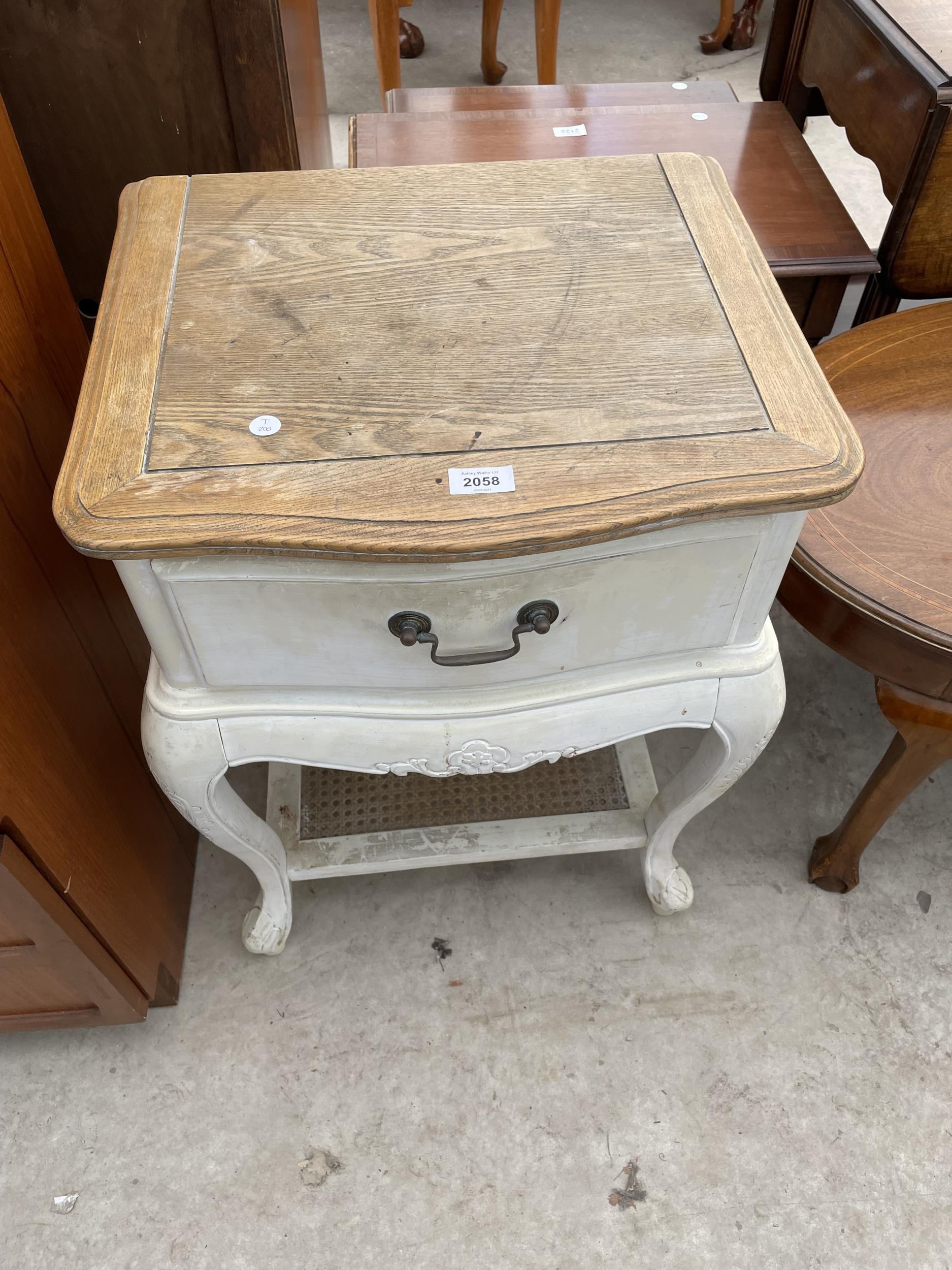 A CONTINENTAL STYLE BEDSIDE TABLE