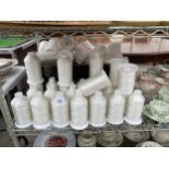 A LARGE QUANTITY OF INDUSTRIAL SEWING MACHINE BOBBINS WITH COTTON