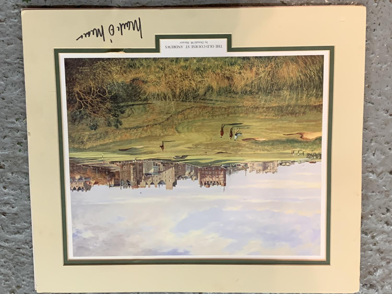 A MOUNTED PRINT OF THE OLD COURSE ST ANDREWS WITH AN INDISTINCT SIGNATURE