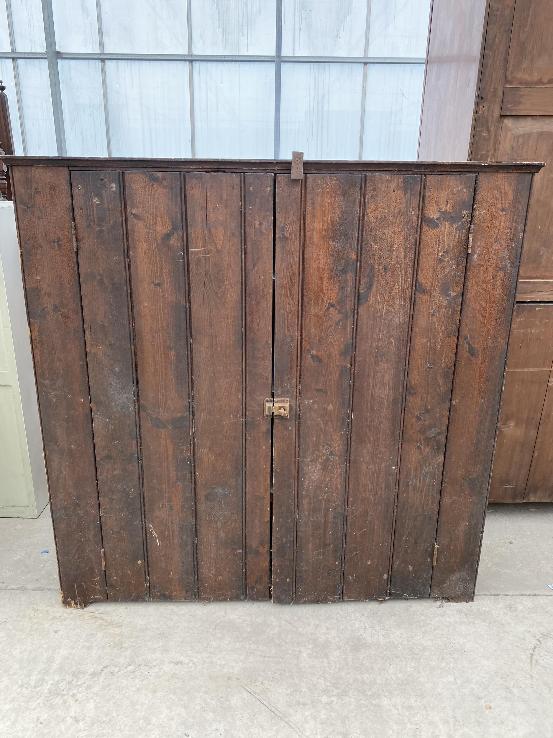"""A TWO DOOR STAINED PINE CUPBOARD 49"""" WIDE"""