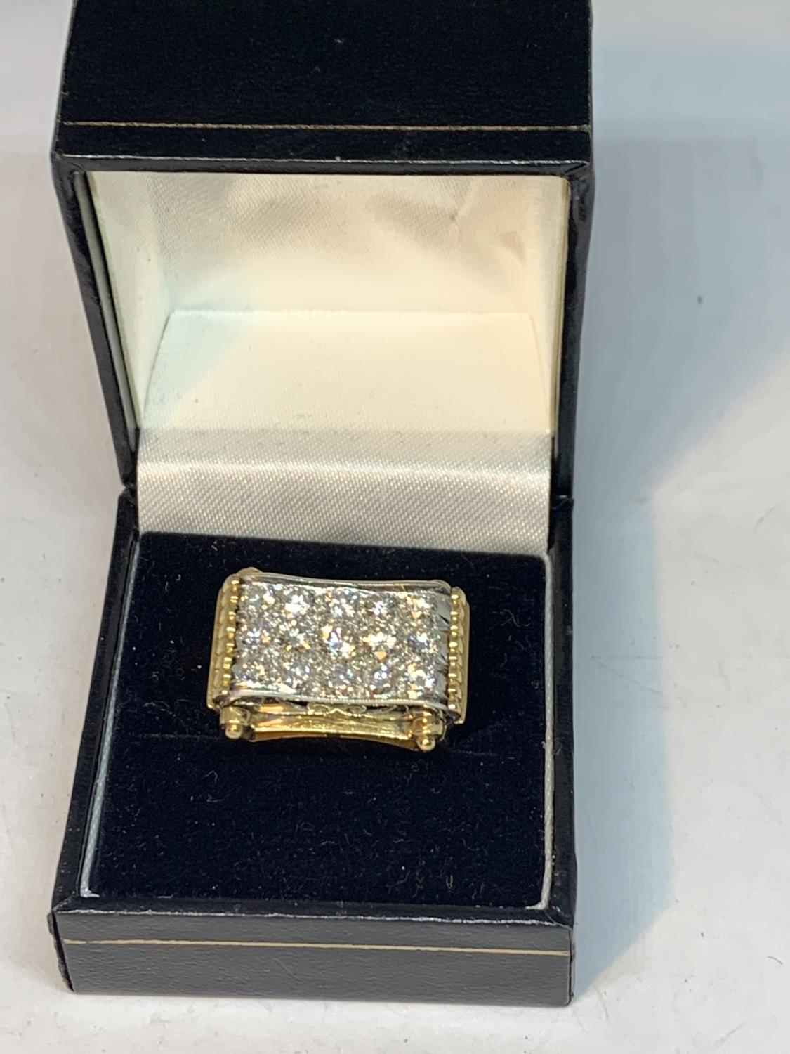 A HEAVY 18 CARAT GOLD RING WITH FIFTEEN DIAMONDS SET IN A RECTANGLE OF DIAMOND CHIPS GROSS WEIGHT 13