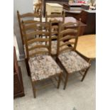 A SET OF FOUR MODERN LADDER-BACK DINING CHAIRS BY NEW PLAN FURNITURE
