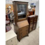 """AN EARLY 20TH CENTURY OAK BUREAU BOOKCASE WITH GLAZED AND LEADED UPPER PORTION, 26"""" WIDE"""