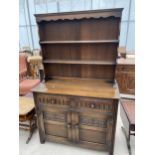 """AN OAK OLD CHARM STYLE DRESSER WITH PLATE RACK 42"""" WIDE"""