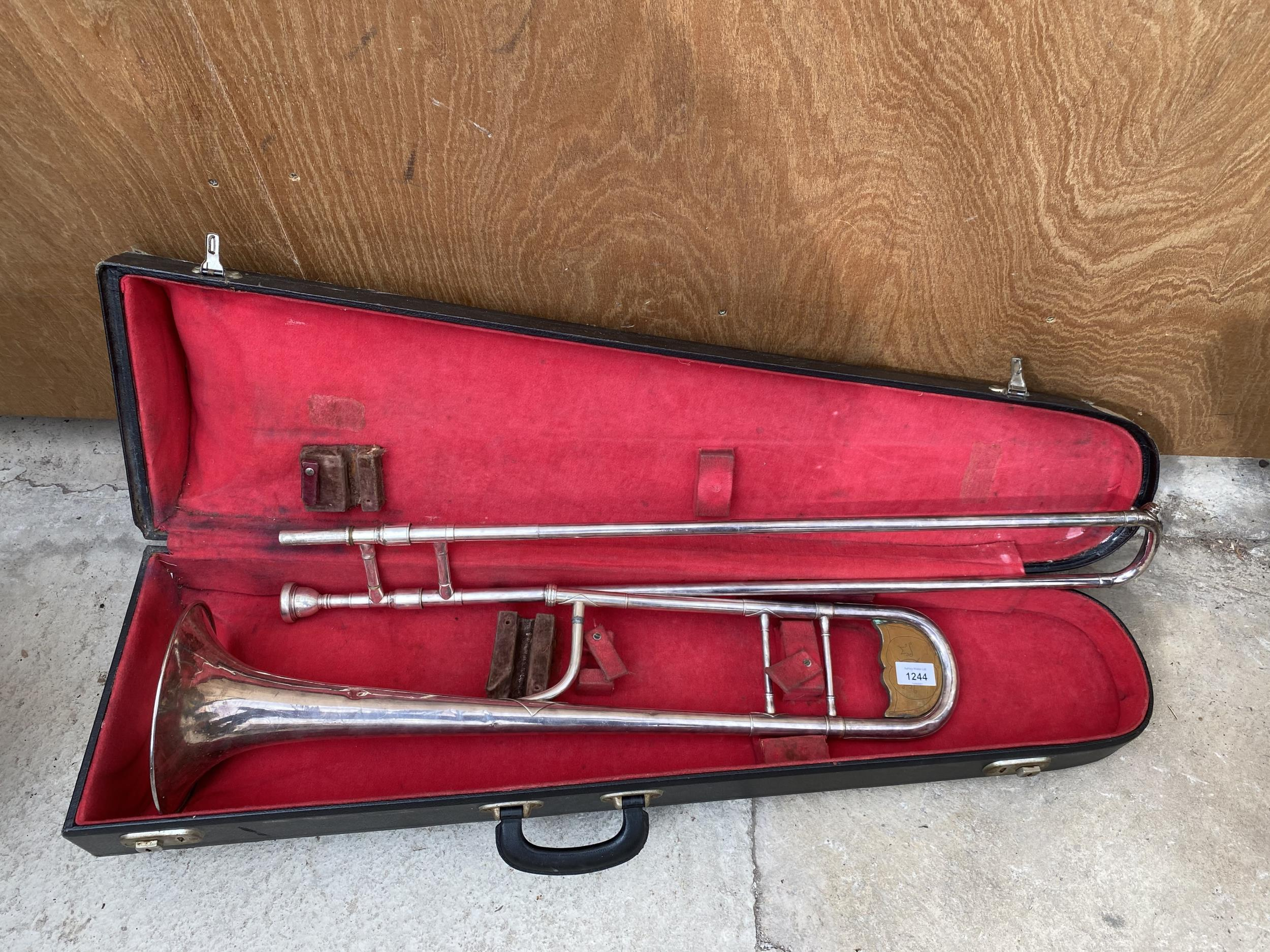 A VINTAGE AND CASED TROMBONE