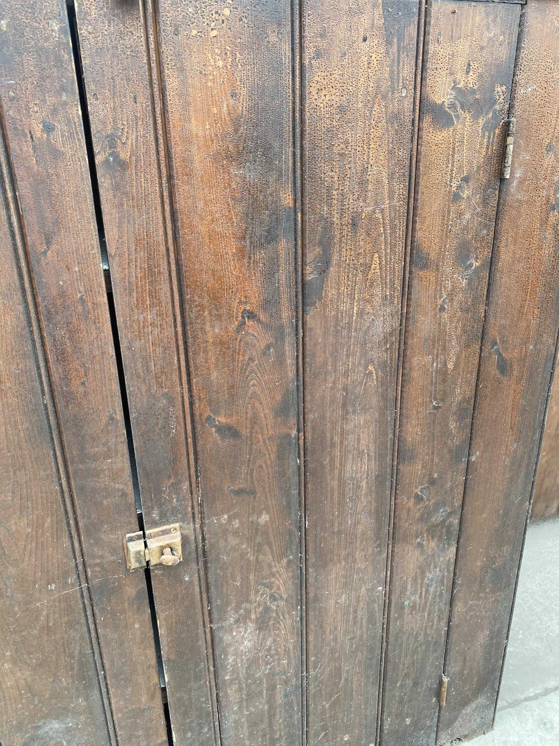 """A TWO DOOR STAINED PINE CUPBOARD 49"""" WIDE - Image 3 of 6"""