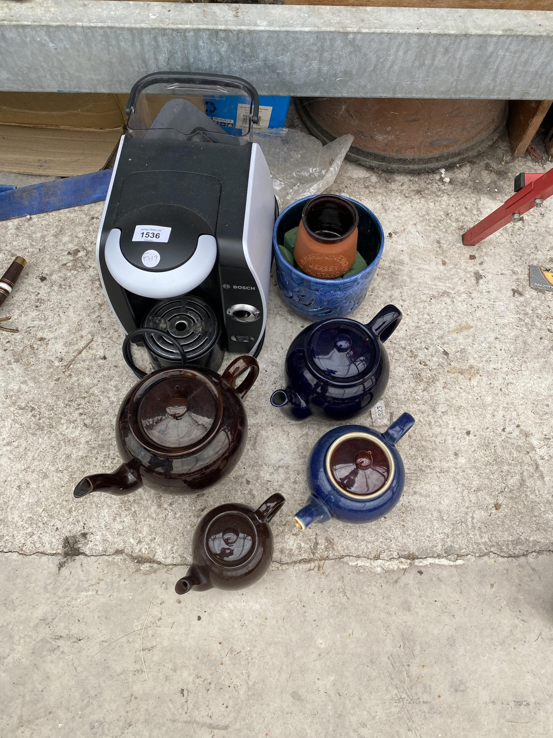 A COFFEE MAKER AND VARIOUS TEAPOTS