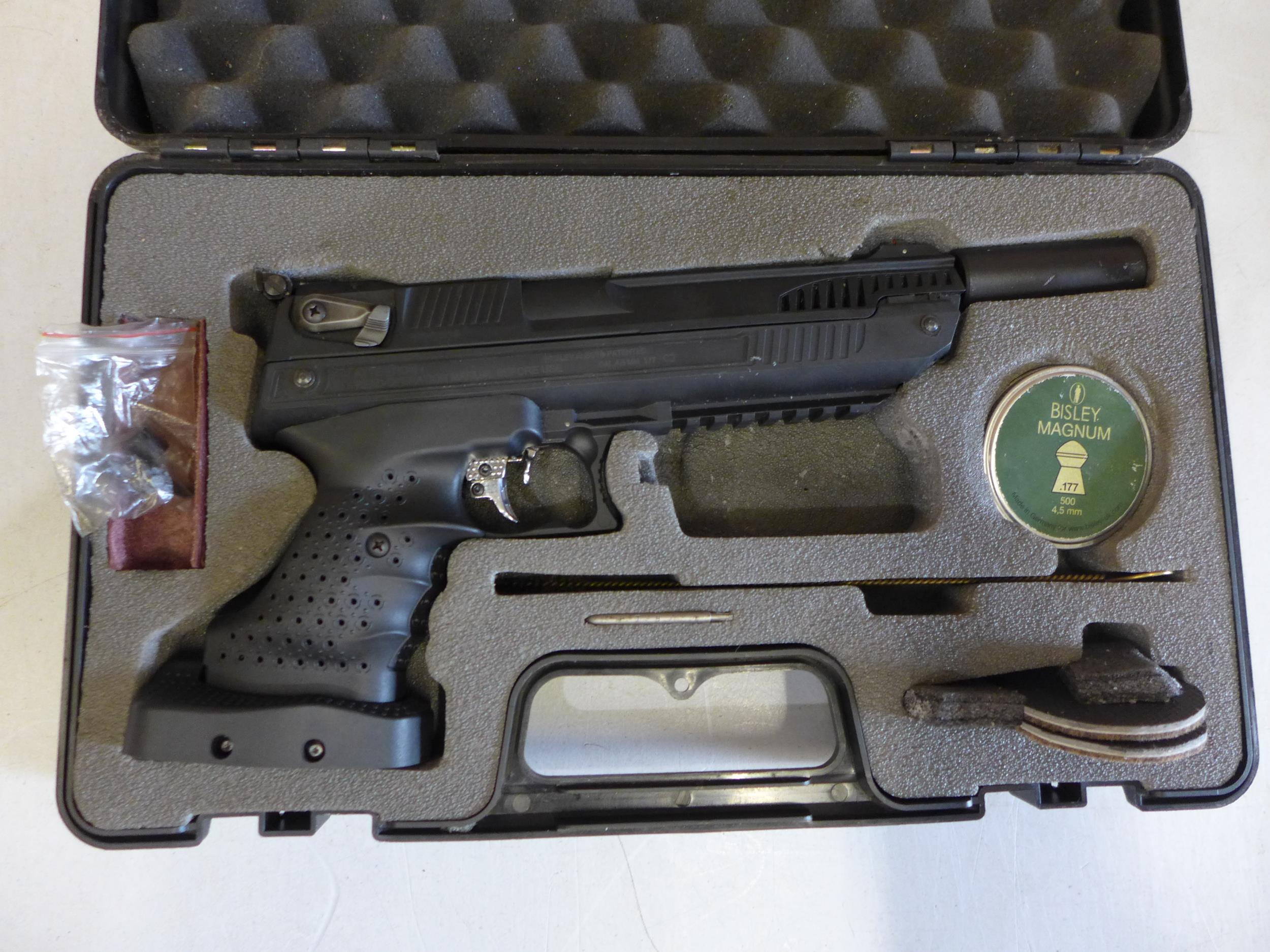 A CASED WEBLEY ALECT .177 CALIBRE AIR PISTOL, WITH SCREW ON SILENCER AND A TIN OF PELLETS