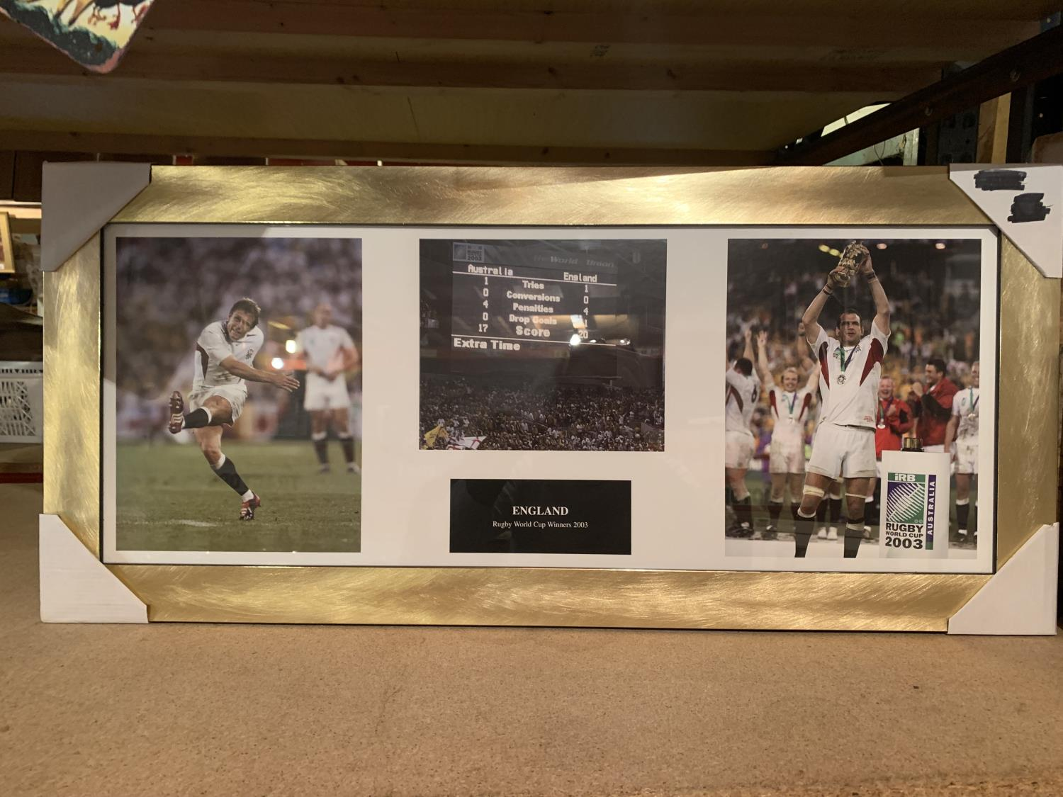 A FRAMED PRINT OF RUGBY WORLD CUP WINNERS 2003