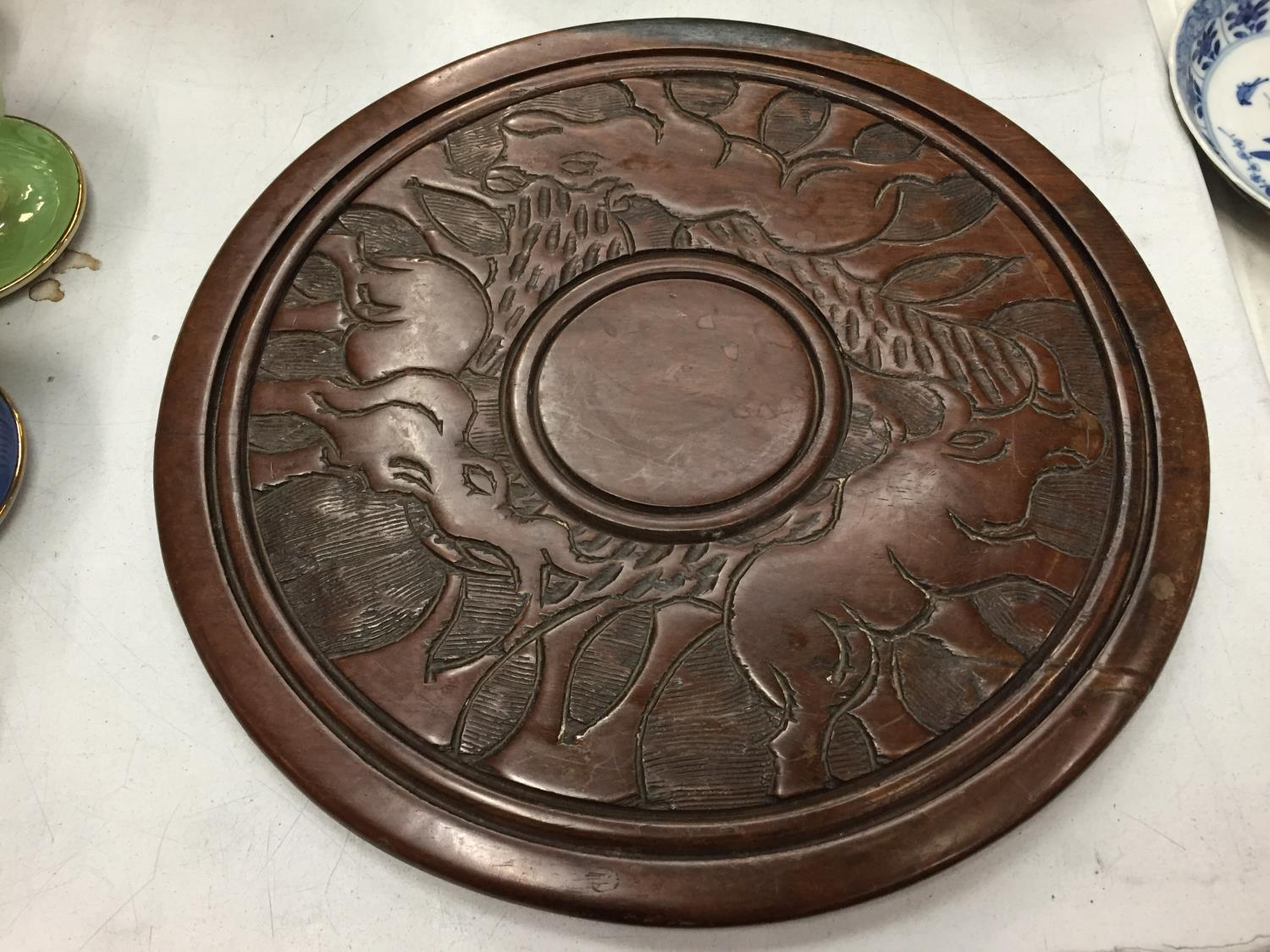 A WOODEN CARVED TRIBAL PLAQUE DEPICTING AN ELEPHANT - Image 2 of 2