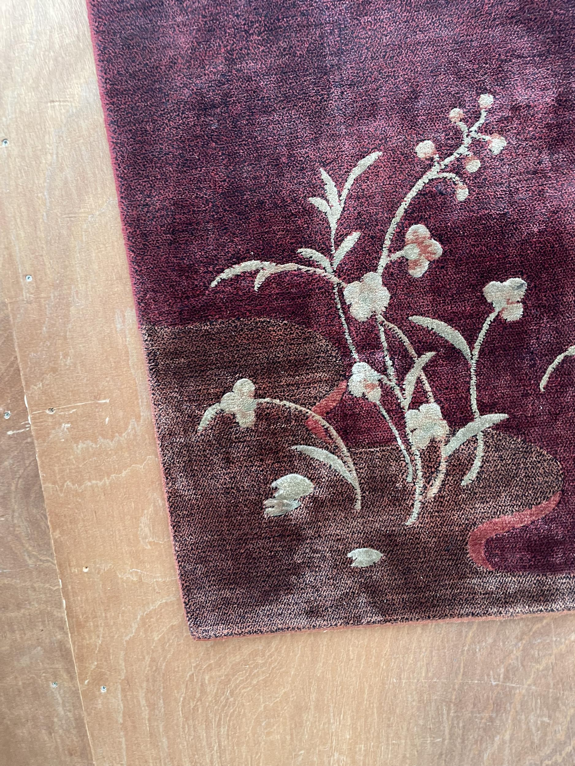 A LARGE MODERN RED PATTERNED RUG - Image 2 of 3