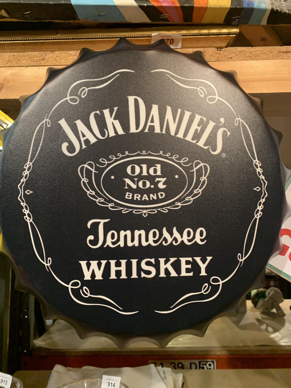 A JACK DANIELS BOTTLE TOP WALL HANGING SIGN