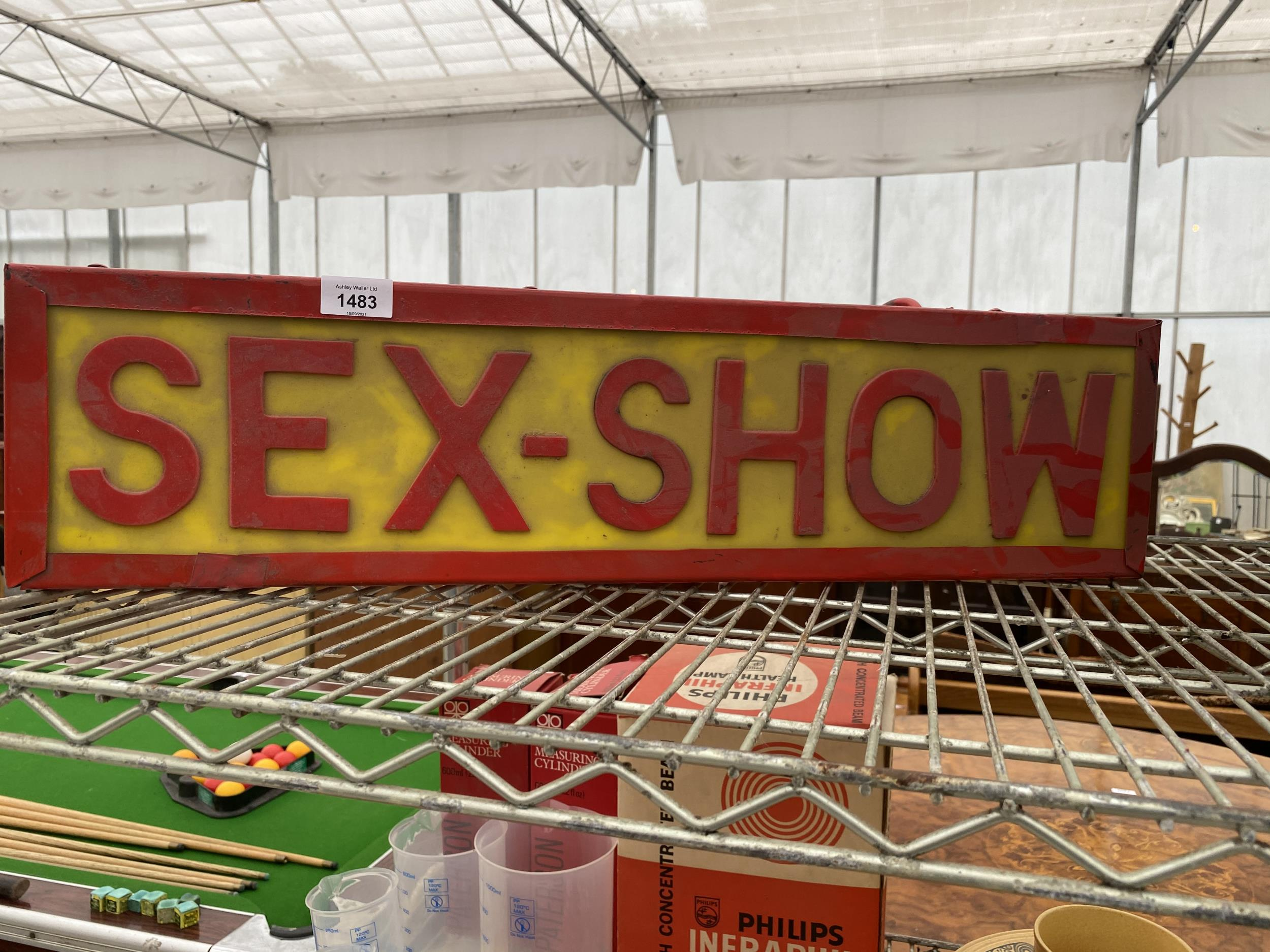 AN ILLUMINATED 'SEX-SHOW' SIGN