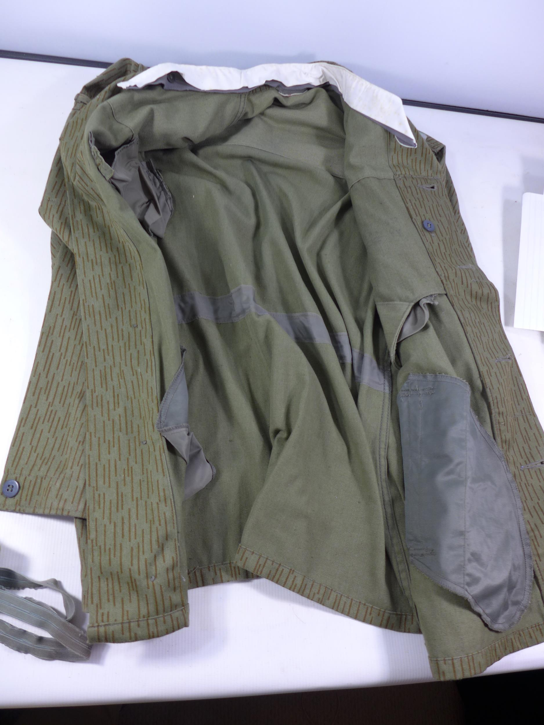 A POST WWII UNIFORM, PROBABLY GERMAN COMPRISING OF A JACKET AND TROUSERS - Image 2 of 6
