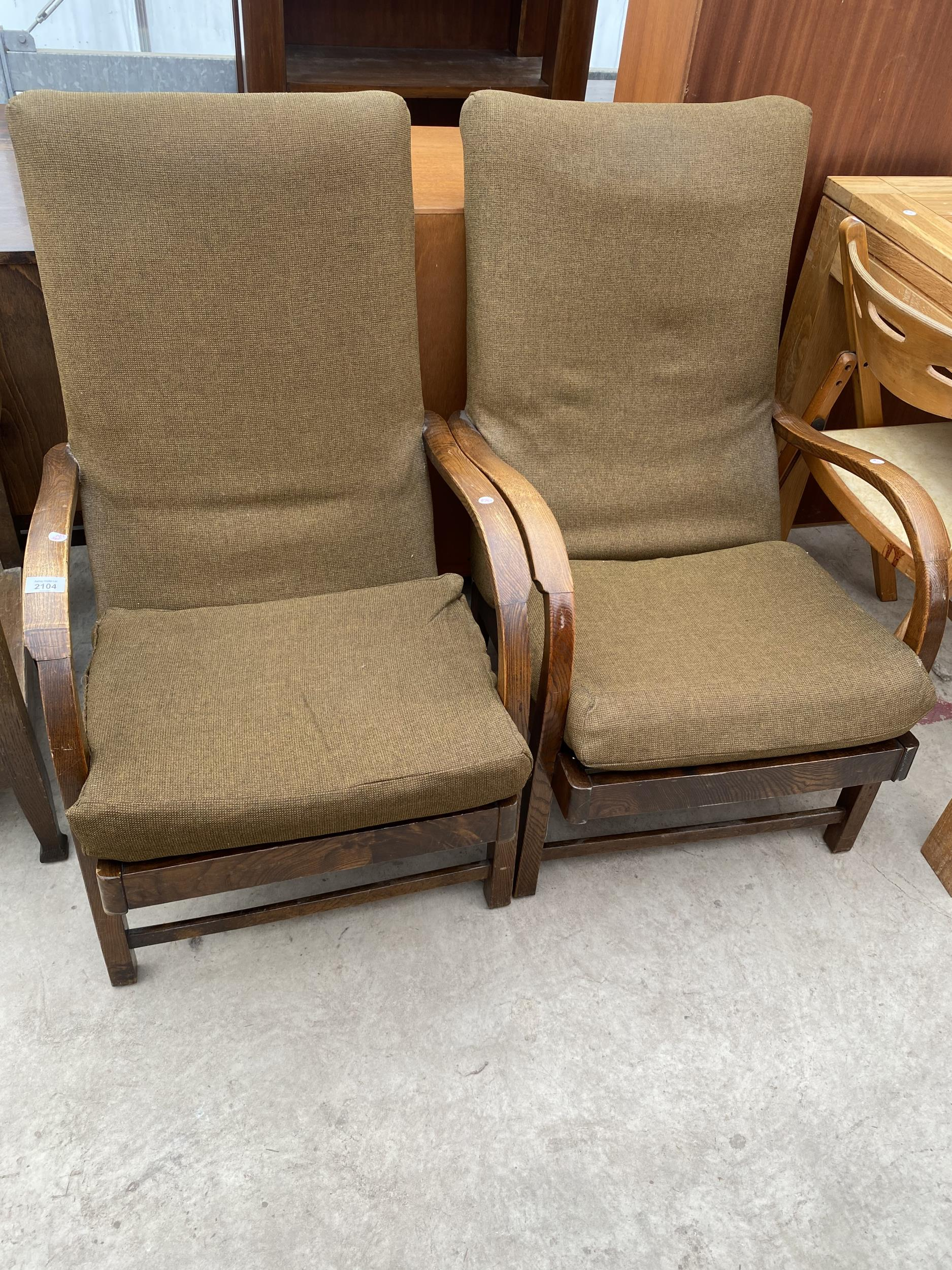 A PAIR OF ART DECO STYLE FIRESIDE CHAIRS