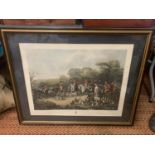 A FRAMED COLOURED ETCHING OF THE BURY HUNT