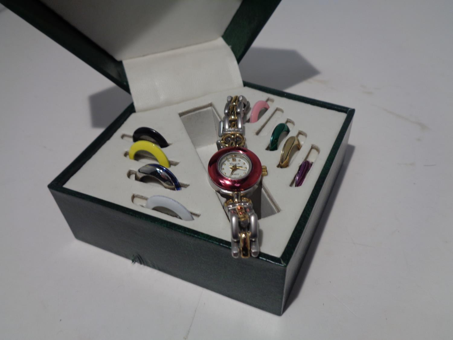 A VIMORA BOXED WATCH WITH COLOURED INTERCHANGEABLE WATCH FACE SURROUNDINGS - Image 5 of 6