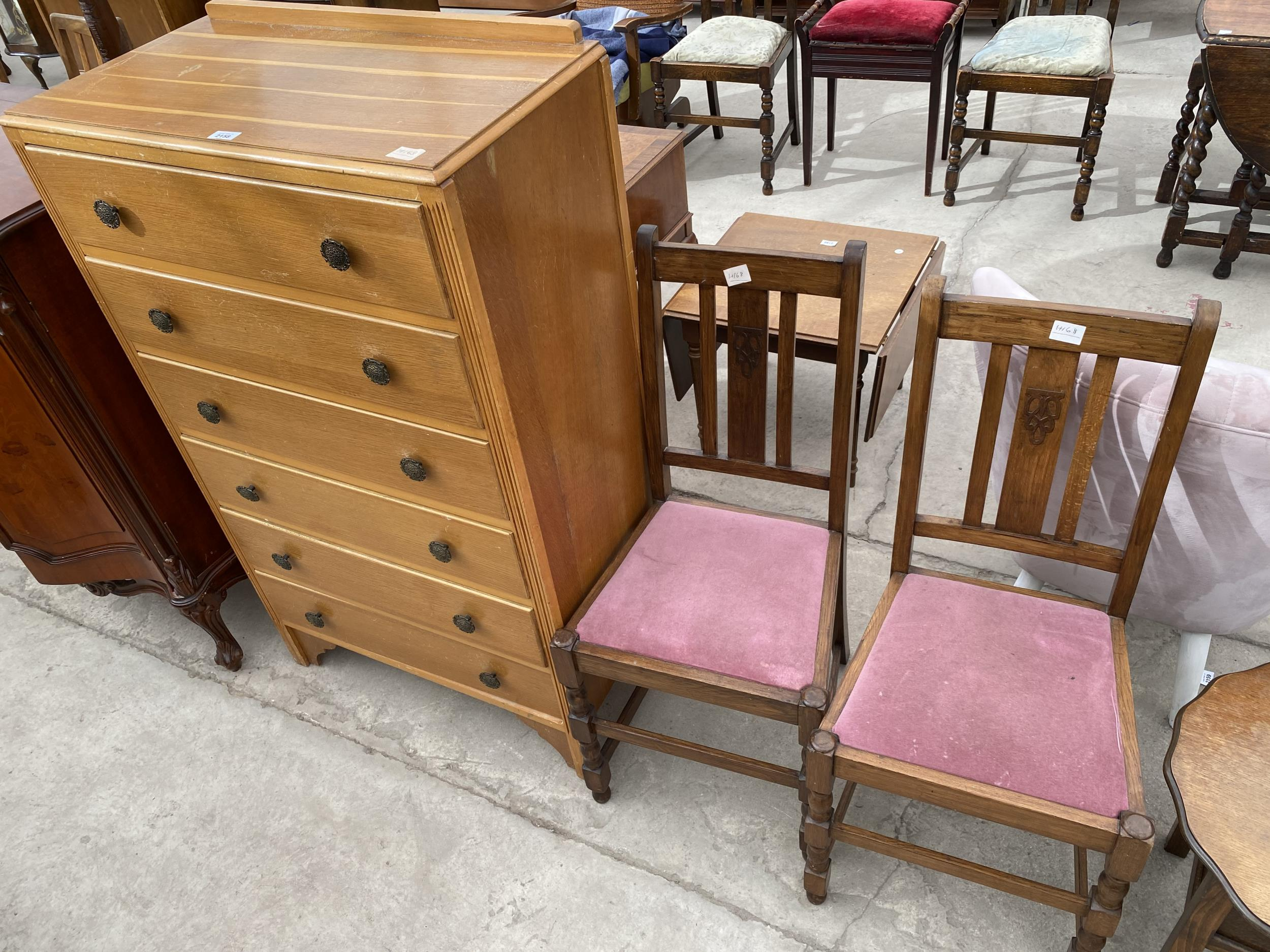 """A MID 20TH CENTURY LIGHT OAK CHEST OF SIX DRAWERS 30"""" WIDE AND A PAIR OF OAK DINING CHAIRS"""