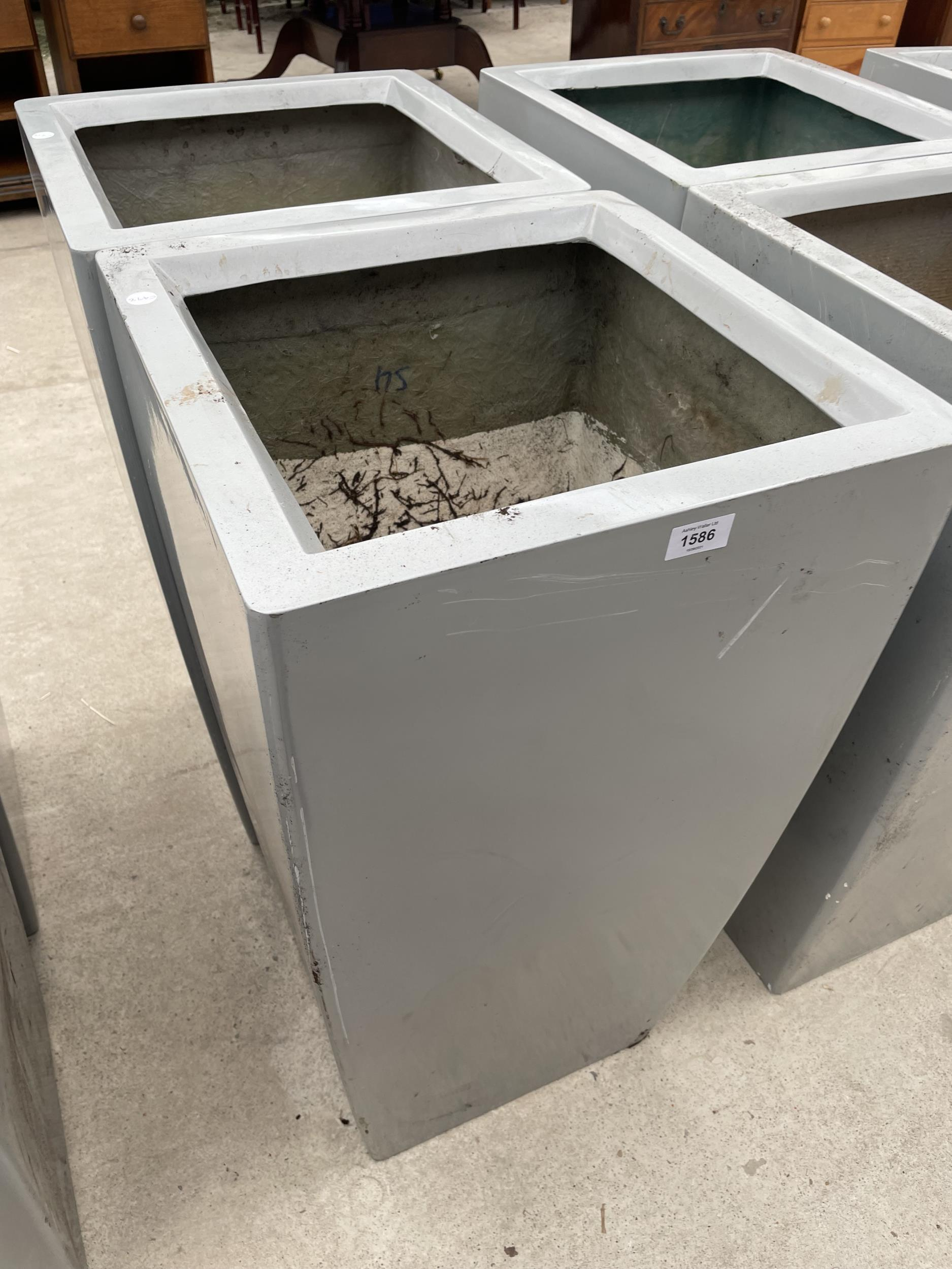 TWO LARGE GREY PLASTIC PLANTERS