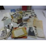 A COLLECTION OF WWII MEMORABILIA COMPRISING PHOTOS OF CAPTURED NAZI FLAG, WAR DIARY, MONEY ETC