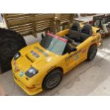 A CHILDRENS BATTERY POWERED RIDE ON CORVETTE CAR WITH CHARGER