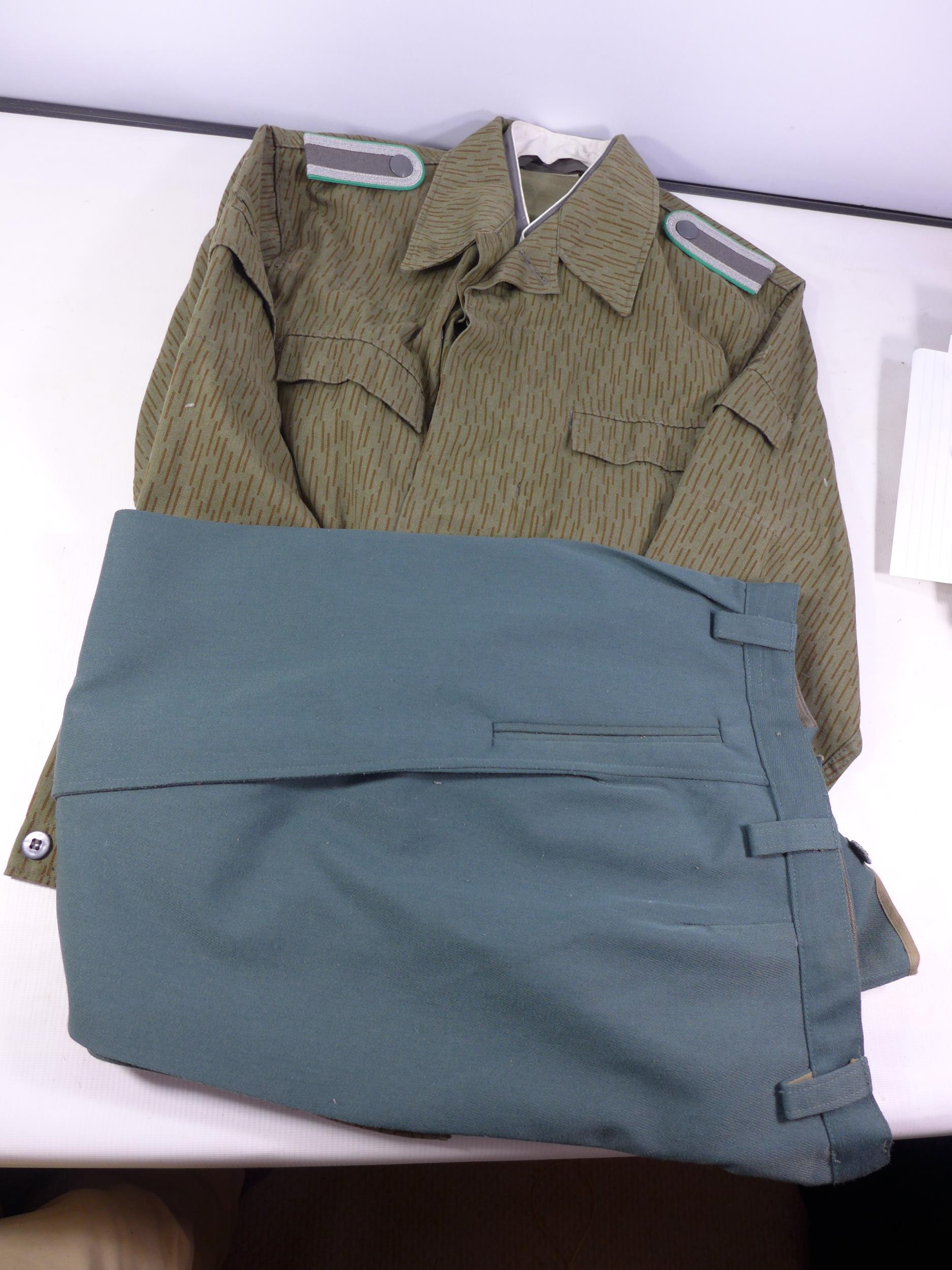 A POST WWII UNIFORM, PROBABLY GERMAN COMPRISING OF A JACKET AND TROUSERS