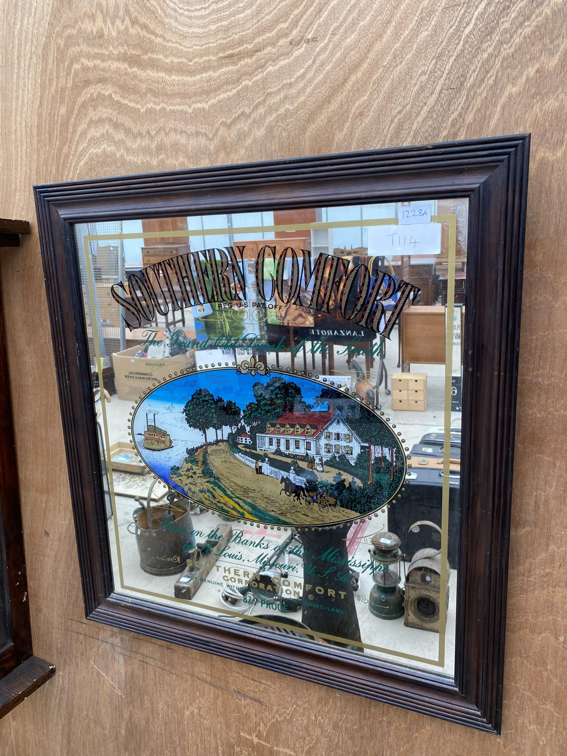 A WOODEN FRAMED 'SOUTHERN COMFORT' ADVERTISING PUB MIRROR