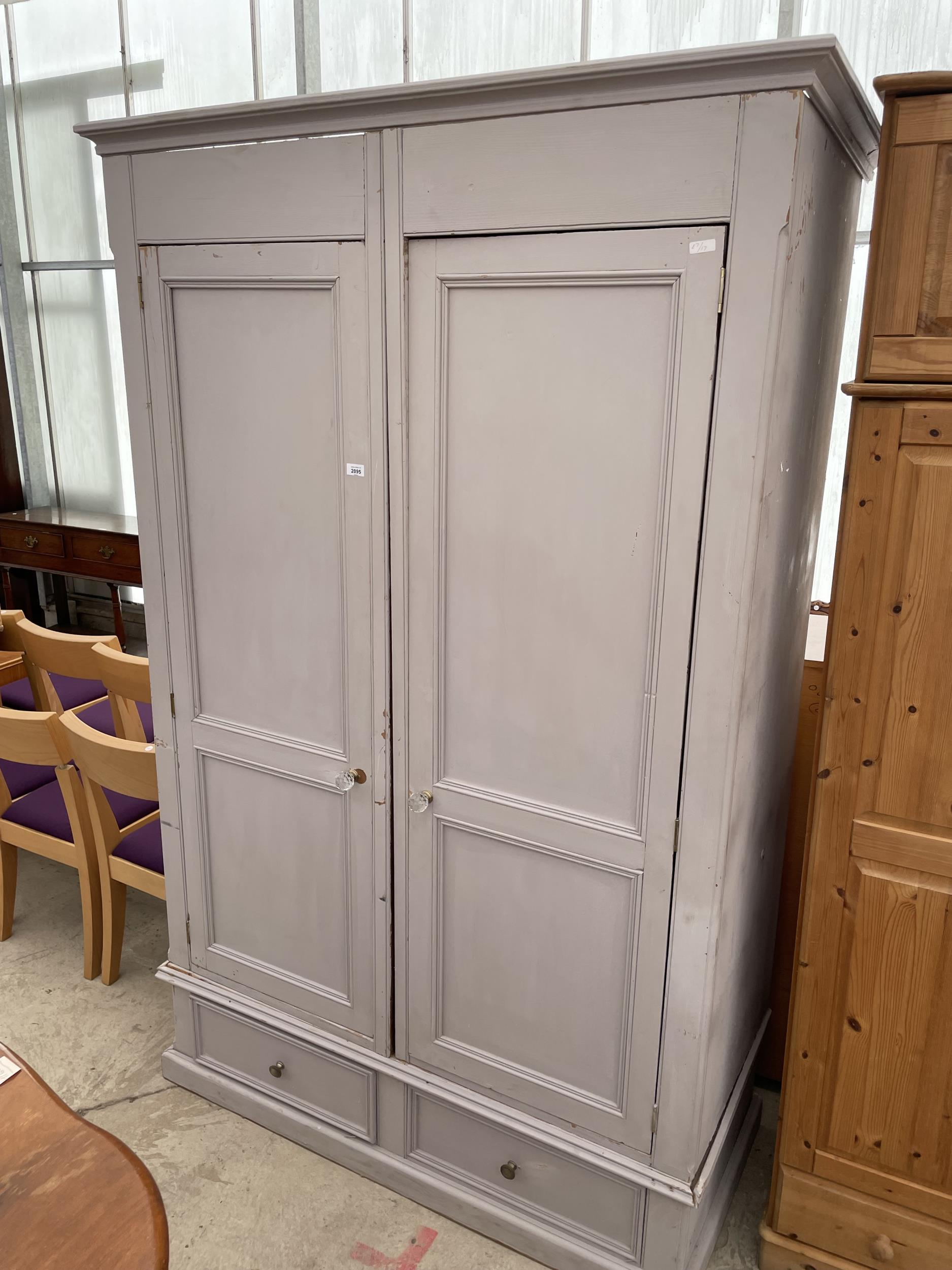 """A PAINTED PINE TWO DOOR WARDROBE WITH TWO DRAWERS TO THE BASE W:56.5"""" H:88"""""""