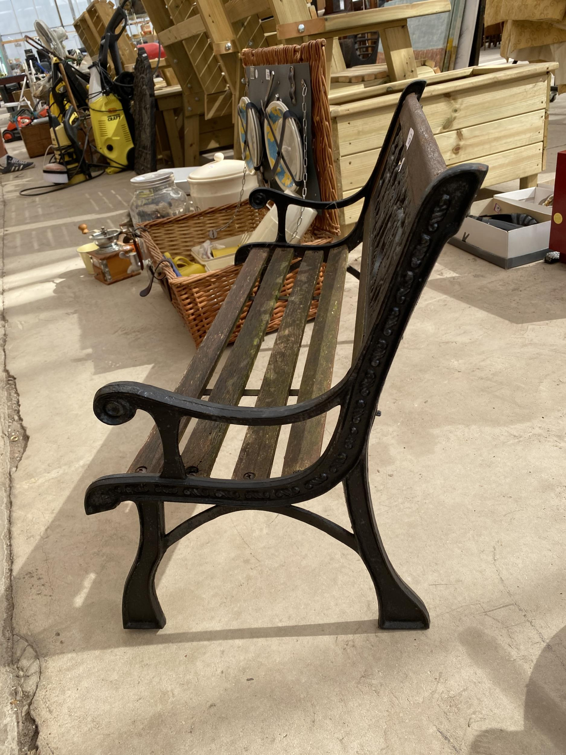 A SMALL CHILDRENS GARDEN BENCH WITH CAST BENCH ENDS AND A CAST BACK DEPICTING A SAFARI SCENE - Image 3 of 3