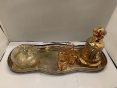 A SILVER PLATED TRAY WITH ORNATE DECANTER, FOUR GLASSES AND A LIDDED JAR