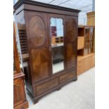 """AN EDWARDIAN MAHOGANY MIRROR DOOR WARDROBE WITH TWO DRAWERS TO BASE, 64"""" WIDE"""