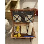 A WICKER PICNIC HAMPER WITH PLATES, CUTTLERY AND CUPS ETC