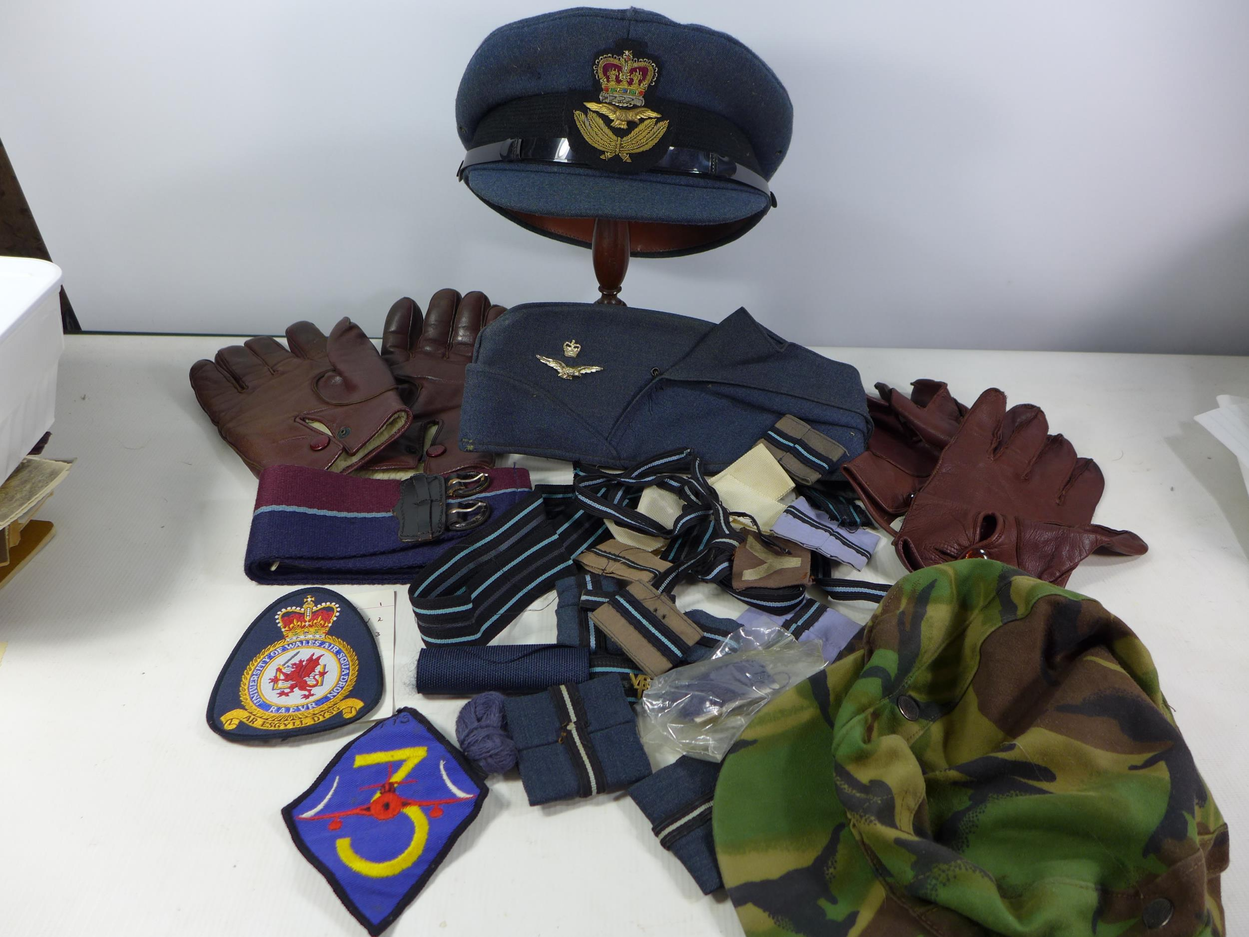 A COLLECTION OF RAF MEMORABILIA COMPRISING CAP, GLOVES, BELTS, FLASHES ETC