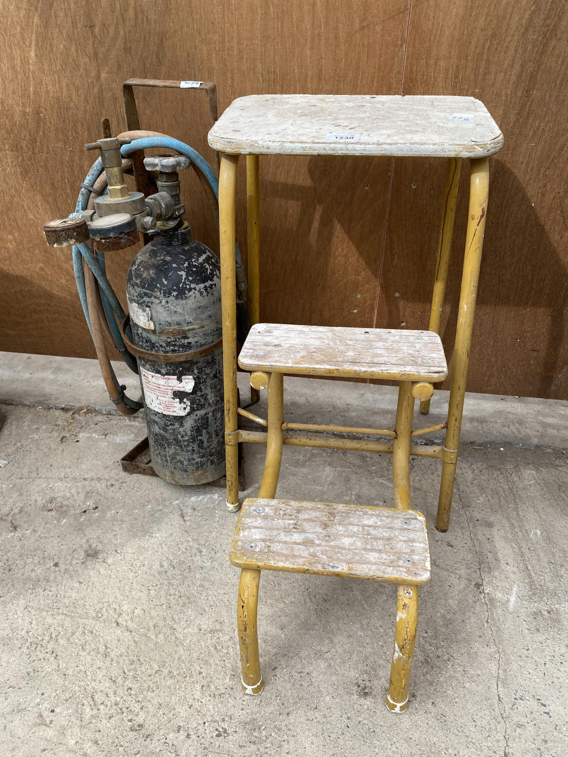 A VINTAGE KITCHEN STEP AND A GAS CUTTING BOTTLE