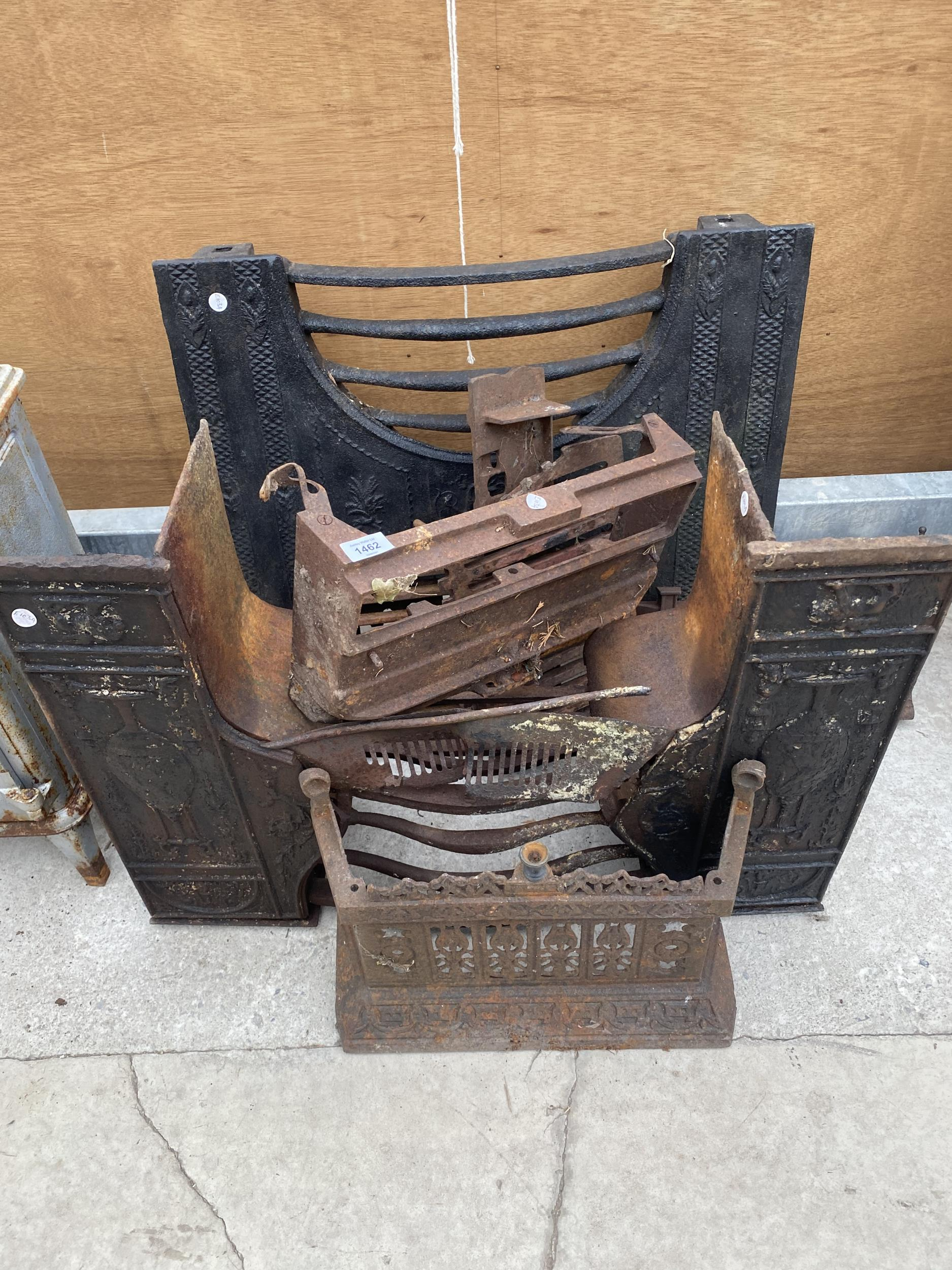 AN ASSORTMENT OF CAST IRON FIRE FRONTS AND FIRE GRATES ETC