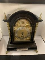 A VICTORIAN EBONISED BRACKET CLOCK WITH SILVERISED DIAL, GILDED DECORATION AND PIERCED SIDE