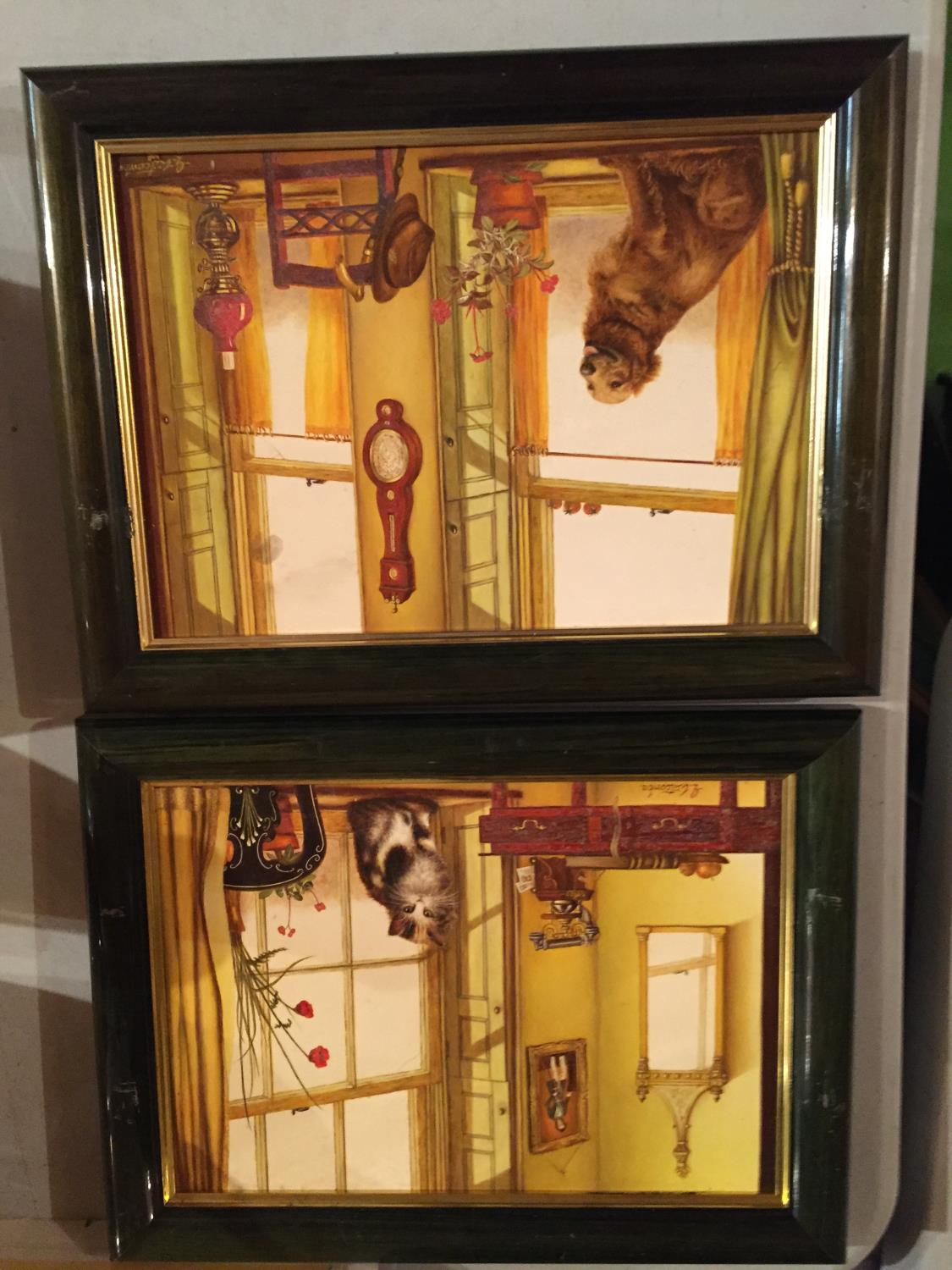 TWO FRAMED PAINTINGS OF A CAT IN A WINDOW AND A DOG IN A WINDOW