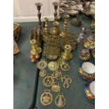 A VINTAGE COLLECTION OF BRASS ITEMS TO INCLUDE THREE LETTER RACK HOLDERS , SIX CANDLE STICK