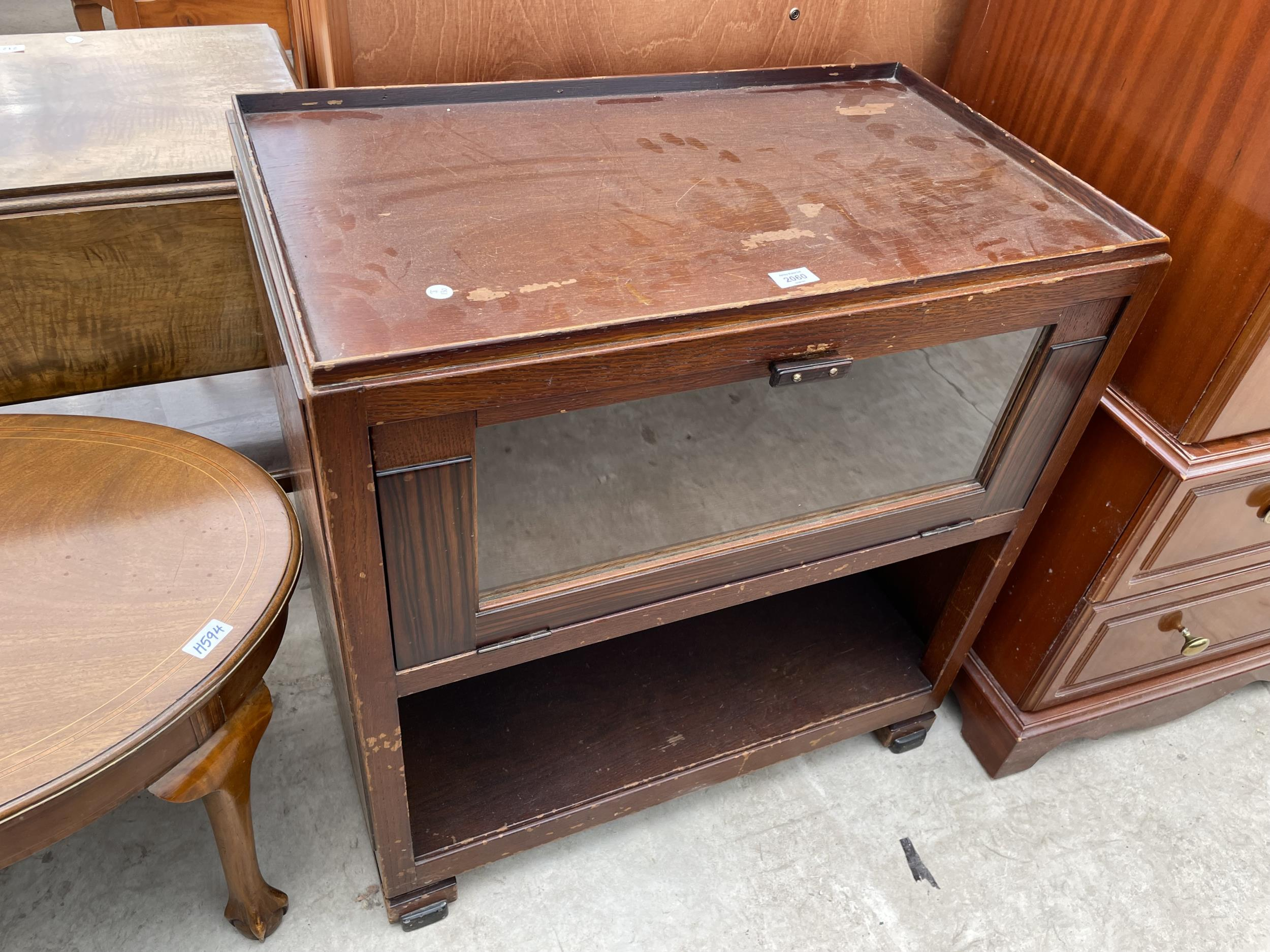 """A MID 20TH CENTURY OAK CABINET WITH DROP-DOWN GLASS DOOR ON OPEN BASE, 30"""" WIDE"""