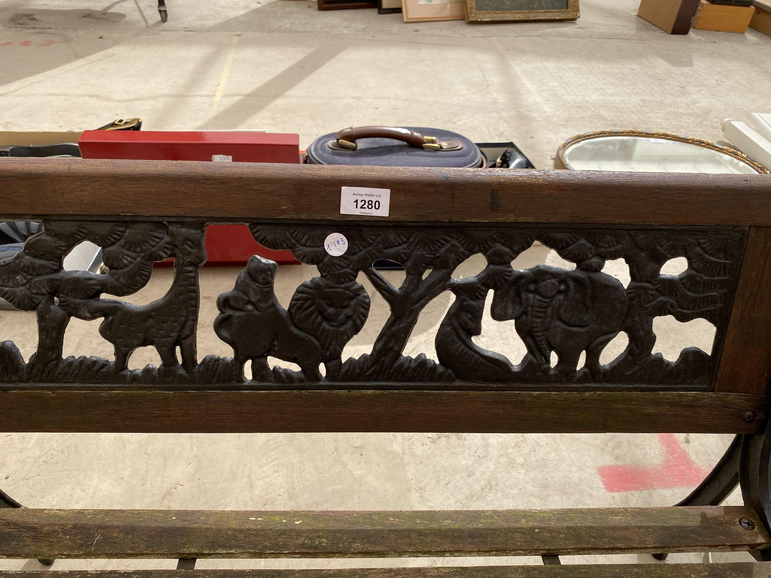 A SMALL CHILDRENS GARDEN BENCH WITH CAST BENCH ENDS AND A CAST BACK DEPICTING A SAFARI SCENE - Image 2 of 3