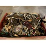 A LARGE BOX OF COSTUME JEWELLERY TO INCLUDE BANGLES, NECKLACES ETC
