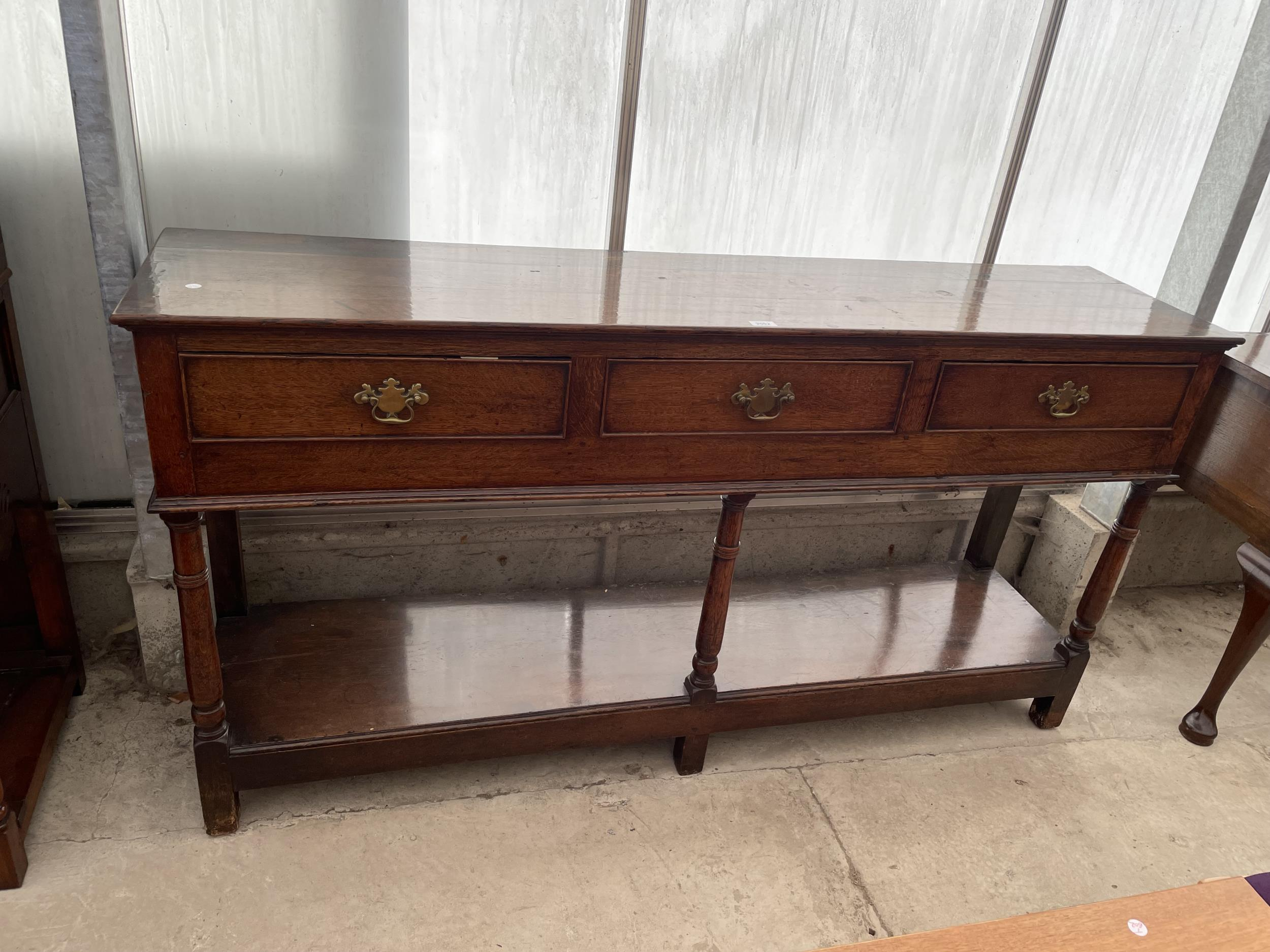 """A GEORGE III OAK DRESSER WITH THREE DRAWERS AND POT BOARD, ON TURNED LEGS, 66.5"""" WIDE"""