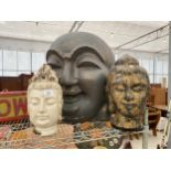 A GROUP OF THREE VARIOUS RESIN BUDDAH AND FIGURE HEADS