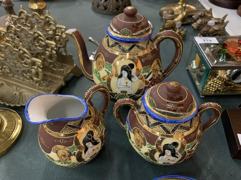 AN ORIENTAL SATSUMA TEA SET TO INCLUDE A TEAPOT, JUG, SUGAR BOWL AND FOUR CUPS AND SAUCERS - Image 2 of 3