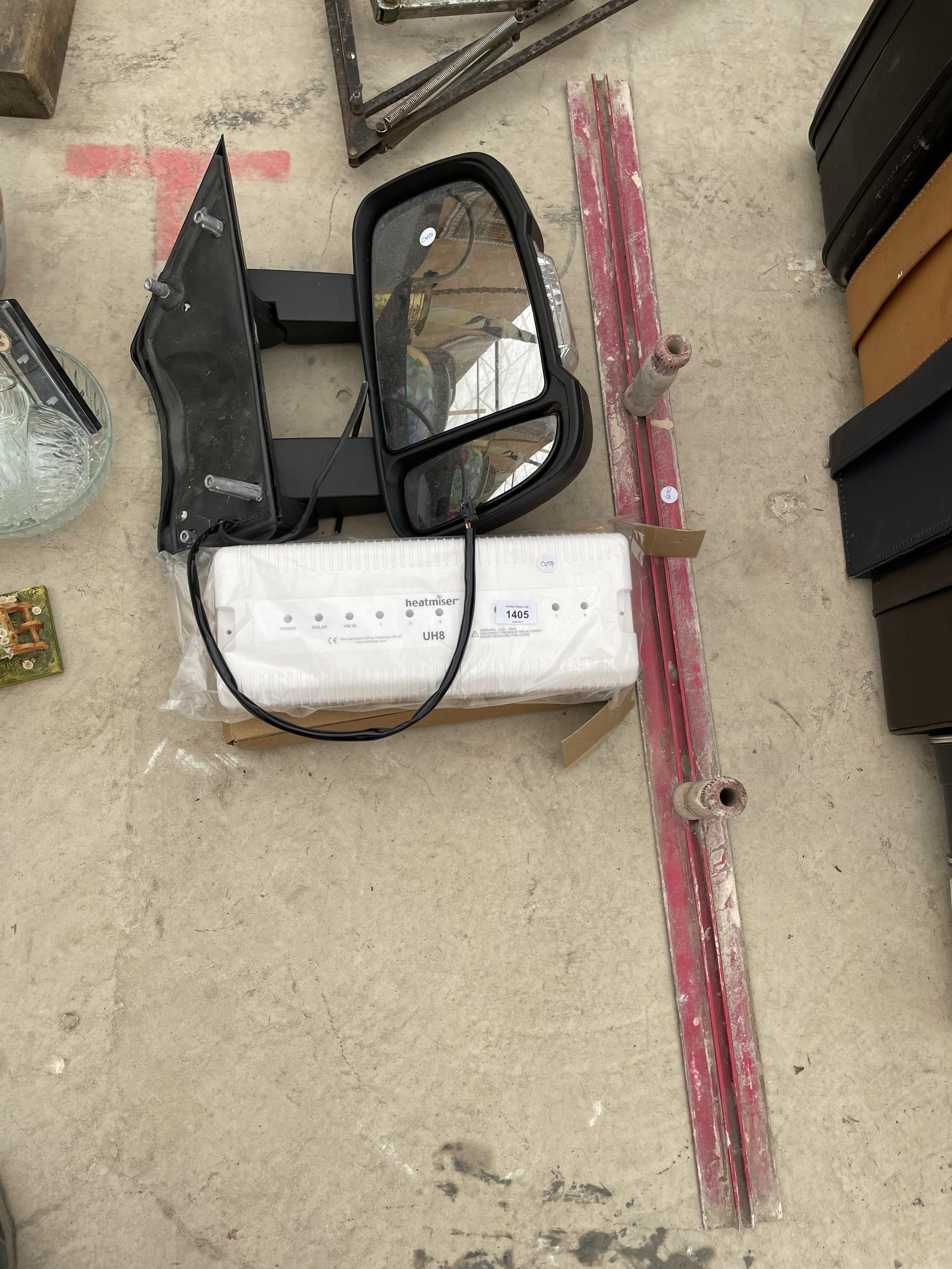 AN ASSORTMENT OF ITEMS TO INCLUDE A LEVELING TROWEL, A HEATMISER AND A VAN WING MIRROR