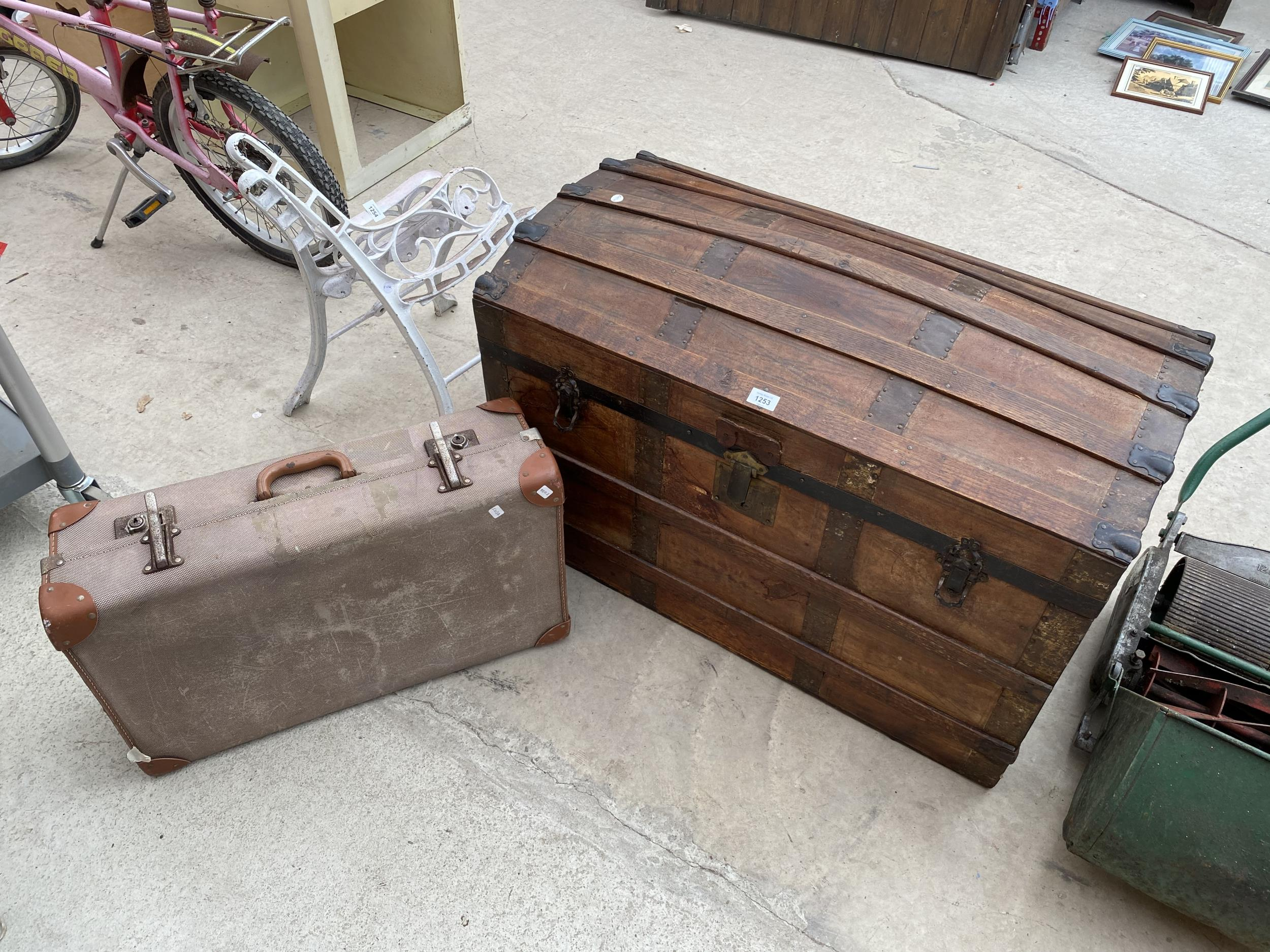 A VINTAGE WOODEN STORAGE CHEST WITH DECORATIVE WOODEN BANDING AND METAL STUD WORK AND A FURTHER