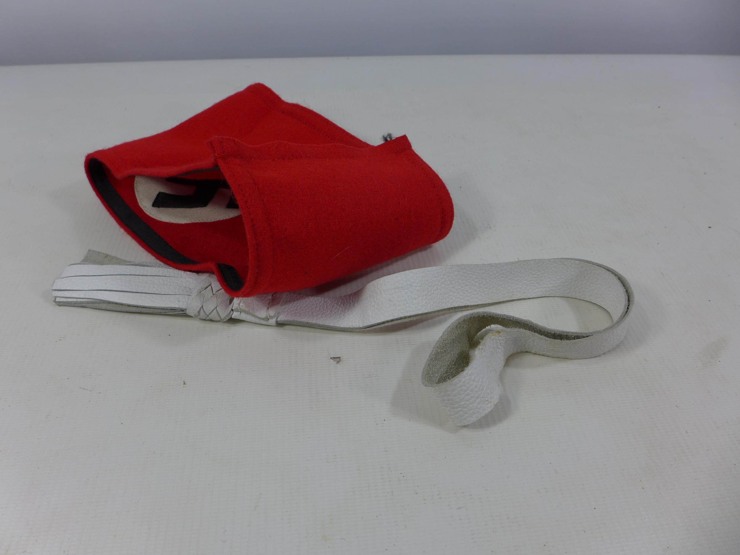 A NAZI ARM BAND AND A WHITE LEATHER TASSLE (2) - Image 3 of 3