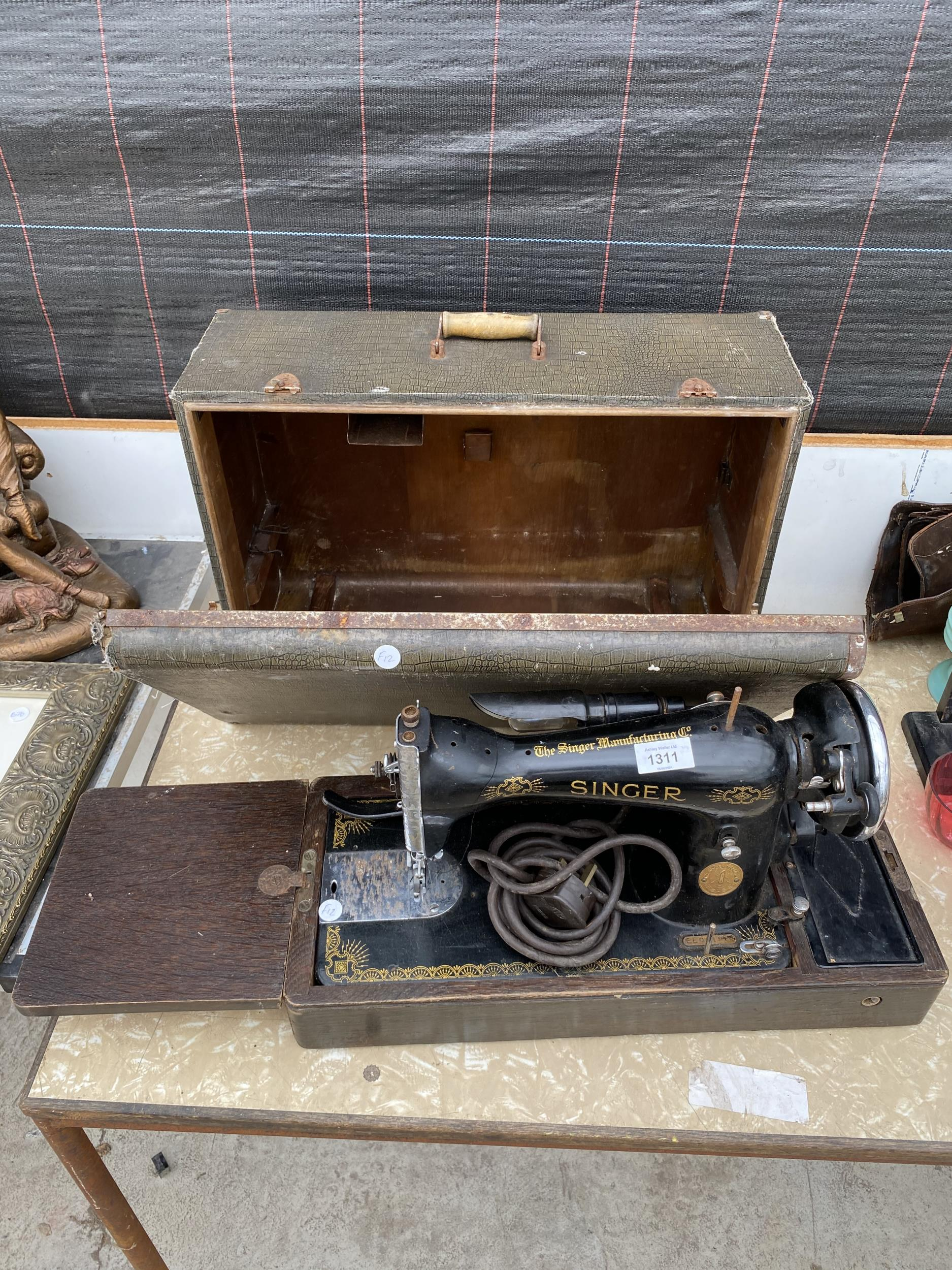 A VINTAGE SINGER SEWING MACHINE WITH LEATHER EFFECT CARRY CASE