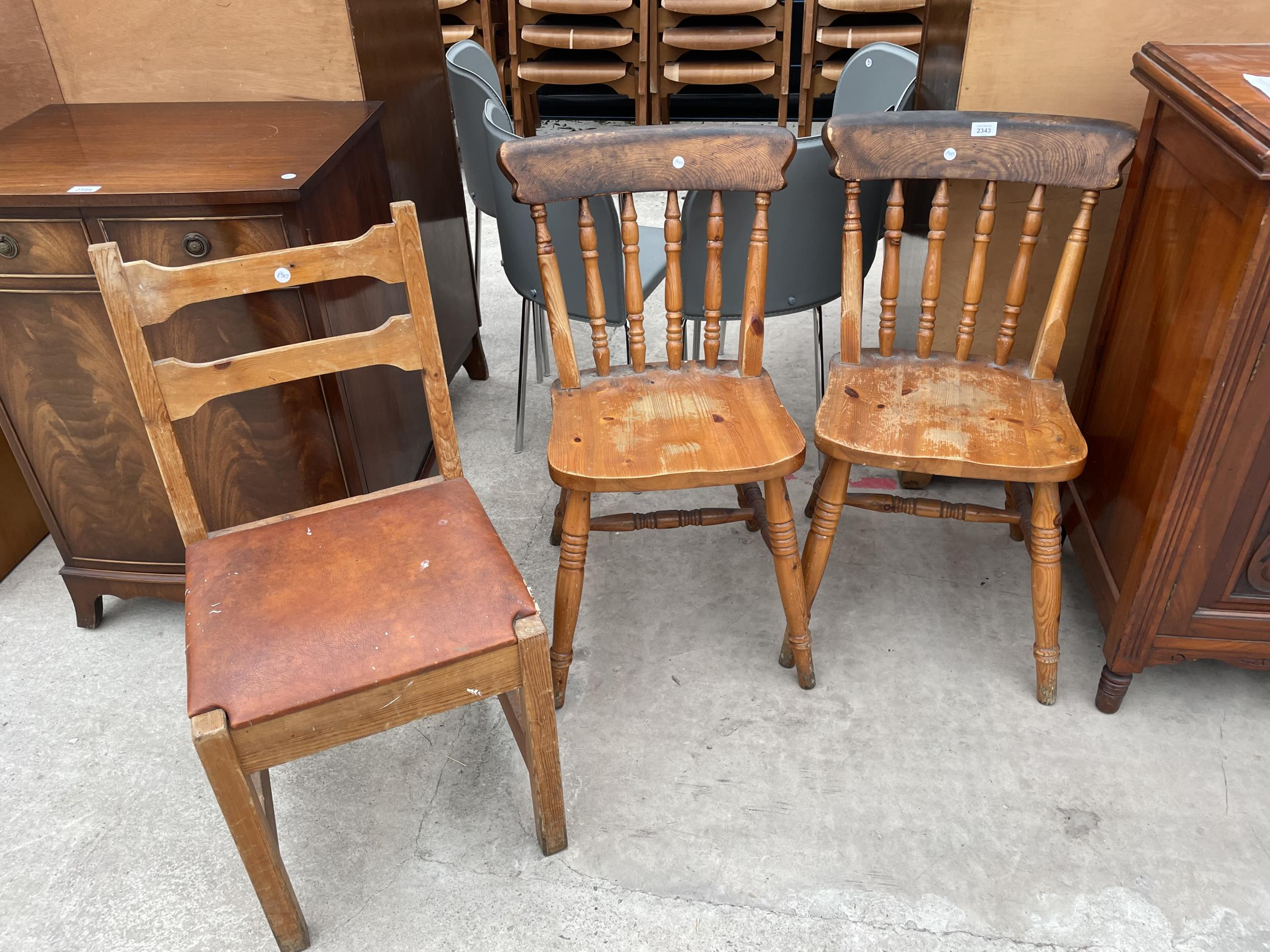 A PAIR OF PINE VICTORIAN STYLE KITCHEN CHAIRS AND SINGLE DITTO